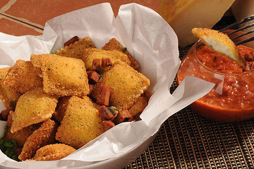 Breaded Four Cheese Ravioli with Grilled Andouille Sausage and Creole Tomato Sauce Recipe Photo