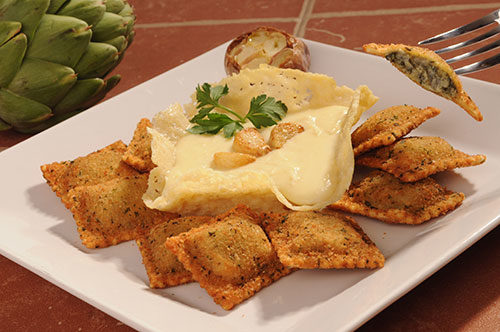 Breaded Spinach and Artichoke Ravioli with Asiago – Roasted Garlic Cream Photo