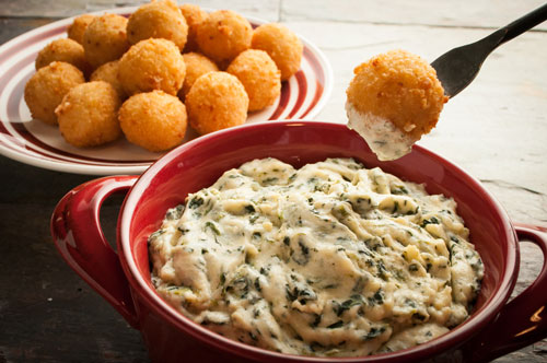 Cheese Risotto Bites Served with Spinach Artichoke Dip