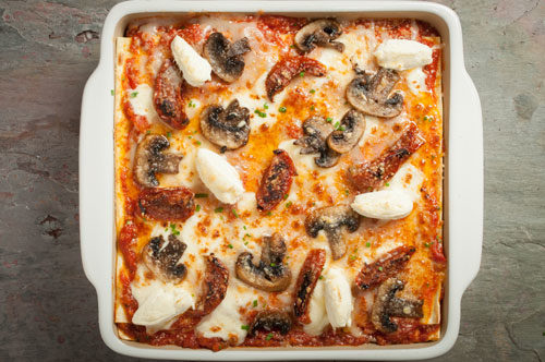Lasagna with Baby Bellas, Sun dried Tomatoes, Goat Cheese Quenelles and San Marzano Tomatoes