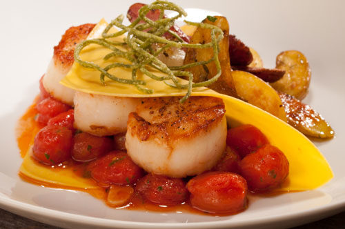 Raviolo Aperto with Jumbo Sea Scallops, Pomodorini and Crisp Fingerlings.
