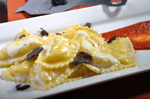Five Cheese Mezzaluna with 'Fonduta' and Tomato Sauce