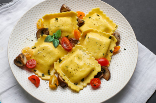 Fonduta Large Square Ravioli with Baby Bella Mushrooms, Grape Tomatoes and Mediterranean Herbs