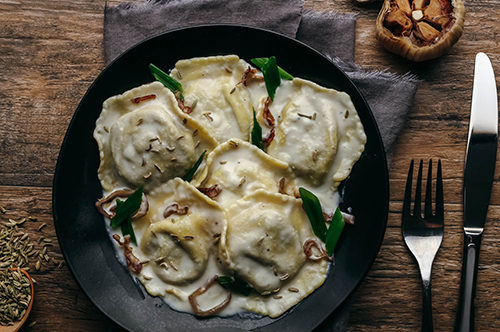 Veal and Portabella Ravioli with Roasted Garlic Cream Sauce & Crispy Shallots