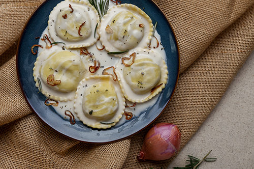 Chianti Braised Beef Ravioli with Rosemary Cream and Crispy Shallots