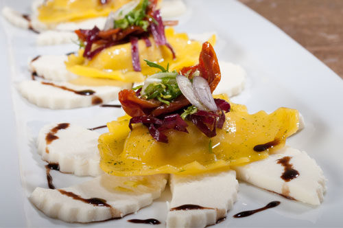 Crabmeat Ravioli with Parmigiano Reggiano Panna Cotta, Micro Salad and Caramelized Onion Reduction