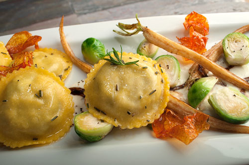 Portabella Mushroom Ravioli with Parsnip Crème, Brussels Sprouts and Tomato Leaf