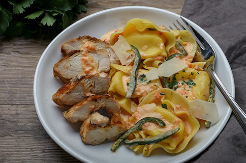 Fonduta Tortellacci with Blackened Chicken and Roasted Red Pepper & Poblano Cream Sauce