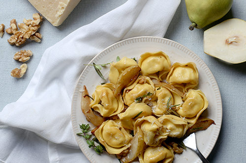 Cheese Tortelloni with Caramelized Pears, Roasted Walnuts, and Herbs