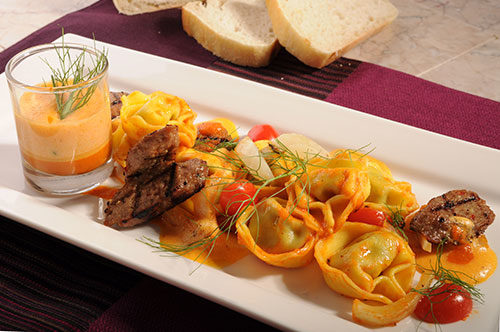 "Cheese, Onion and Garlic Tortelloni with Sausage and ""Zabaglione Salato"""