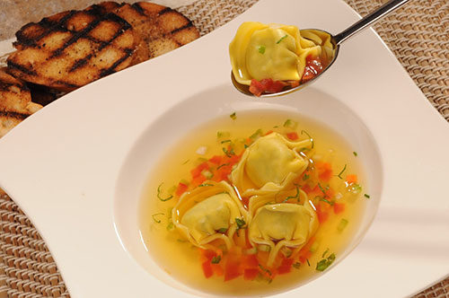 Chicken and Prosciutto Tortelloni with Consommé