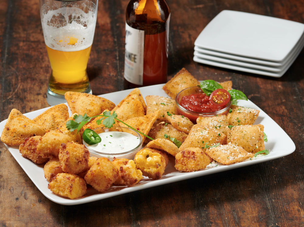 A plate of toasted and breaded appetizers