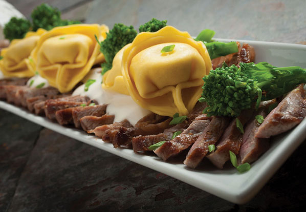 Tortelloni, with broccolini and steak slices