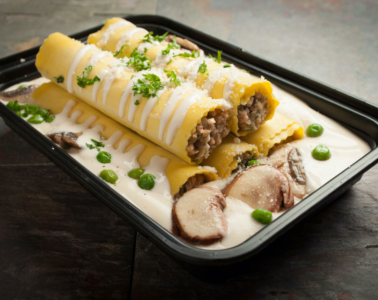 Beef Cannelloni with mushroom, peas and Alfredo sauce